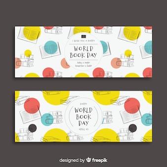 Insegna di giorno del libro di mondo disegnato a mano