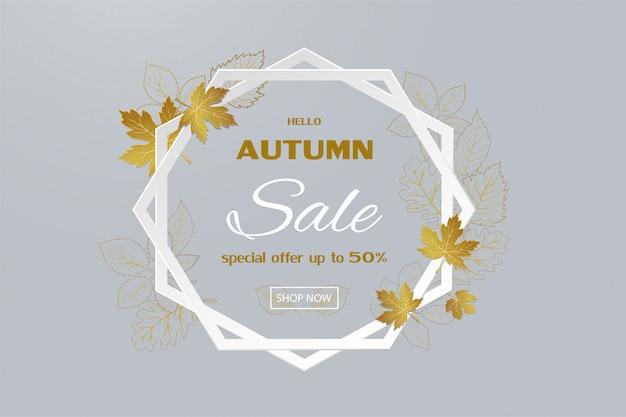 Insegna di vendita di autunno con le foglie dorate sulla struttura di esagono