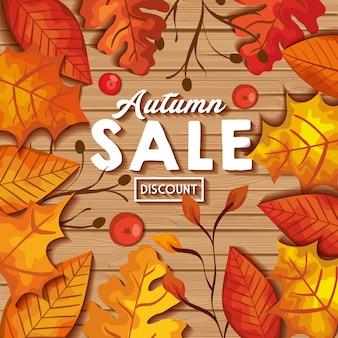 Insegna di vendita di autunno con le foglie su legno