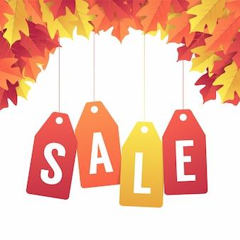 Insegna di vendita di autunno con le foglie variopinte di caduta.