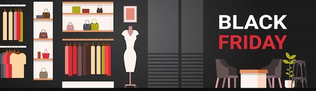 Insegna di vendita di black friday con l'interno del negozio di vestiti di moda