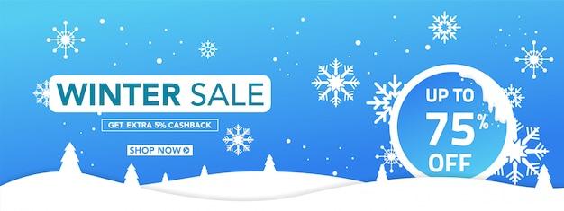 Insegna di vendita di inverno con i fiocchi di neve su fondo blu