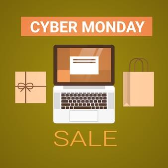 Insegna di vendita di lunedì cyber con la vista di angolo dei sacchetti della spesa e del computer portatile