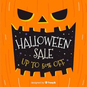 Insegna disegnata a mano di vendita di halloween della zucca