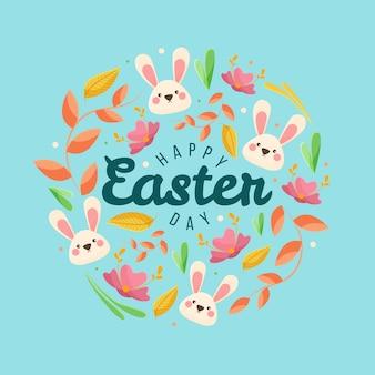 Insegna felice di giorno di pasqua con i coniglietti e le foglie