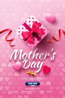 Insegna felice di vendita di festa della mamma con il contenitore di regalo e l'innamorato sul rosa