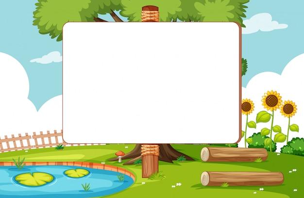 Insegna in bianco nella scena del parco naturale
