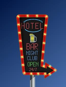 Insegna luminosa dorata della retro freccia con il segno dell'hotel