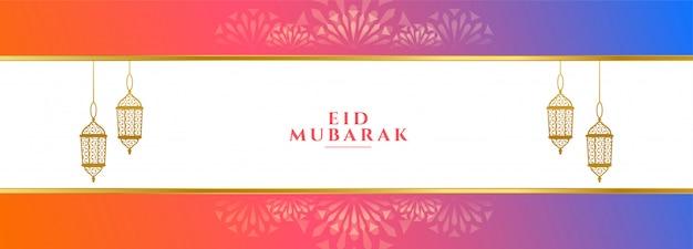 Insegna variopinta di festival di eid mubarak con le lanterne