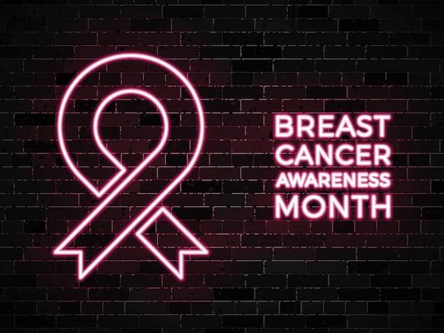 Insegne al neon di mese di consapevolezza del cancro al seno sul muro di mattoni scuro