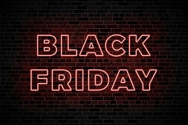 Insegne luminose al neon per la vendita del venerdì nero su sfondo scuro muro di mattoni