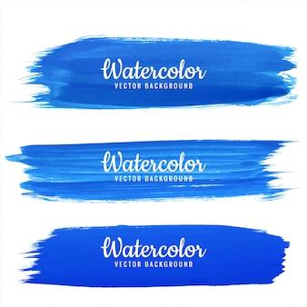 Insieme blu astratto di progettazione del colpo dell'acquerello di tiraggio della mano