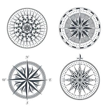 Insieme degli elementi degli emblemi delle etichette dei segni della bussola nautica della rosa dei venti antica d'annata