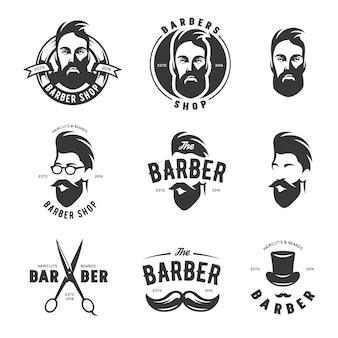 Insieme degli emblemi di vettore del negozio di barbiere dell'annata, etichetta, distintivi ed elementi di design.