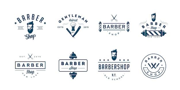 Insieme dei distintivi e degli emblemi del negozio di barbiere dell'annata.