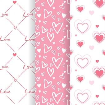 Insieme dei modelli senza cuciture a forma di cuore rosa adorabile