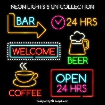 Insieme dei segni al neon luminosi