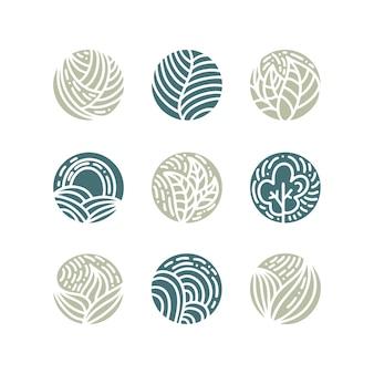 Insieme del logos delle foglie verdi della pianta tropicale