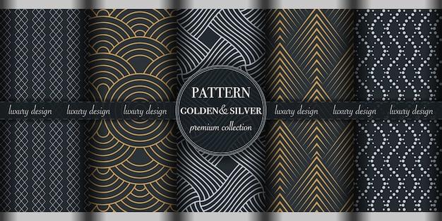 Insieme del modello senza cuciture geometrico astratto dorato e d'argento