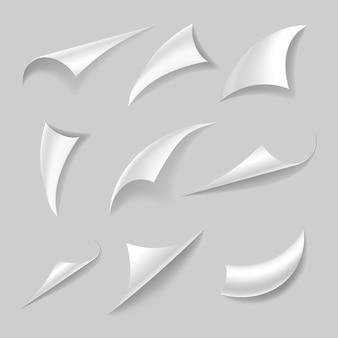 Insieme dell'angolo di pagina arricciato con ombra realistica. bordi e riccioli di carta. sfogliando la pagina del libro, gli angoli in bianco delle carte di curling. illustrazione isolato su sfondo grigio.