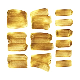 Insieme dello striscio del colpo del pennello dell'oro isolato