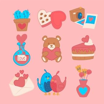 Insieme di elementi dolce del bigné e degli oggetti del biglietto di s. valentino