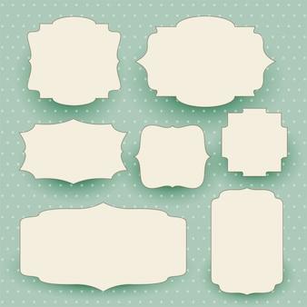 Insieme di etichette bianco d'annata con lo spazio del testo
