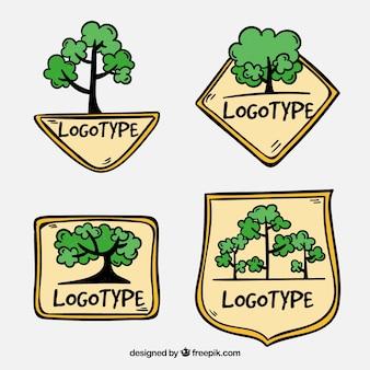 Insieme di logo albero disegnato a mano