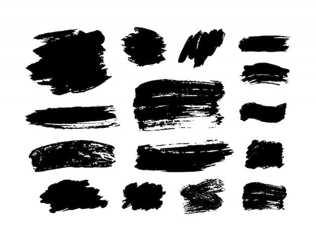 Insieme di pennellate. elementi di design grunge. vernice dorata, inchiostro, pennelli, linee, sgangherata. scatole artistiche sporche, cornici. linee d'oro isolate. illustrazione brillante di arte strutturata dell'oro astratto.