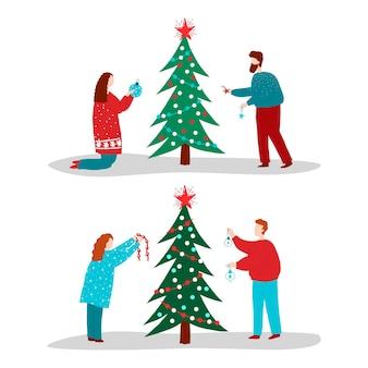 Insieme di persone che decorano l'albero di natale