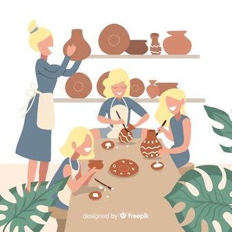 Insieme di persone che fanno la ceramica