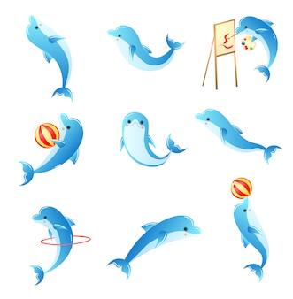 Insieme di piccoli delfini blu del fumetto con diverse attività