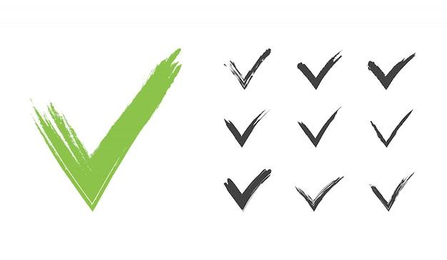 Insieme di segno di spunta verde grunge disegnato a mano