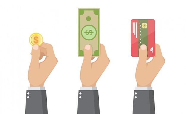 Insieme di uomini d'affari in possesso di carta di credito, monete e banconote