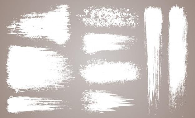 Insieme di vettore delle pennellate artistiche grunge, pennelli. elementi di design creativo. pennellate larghe dell'acquerello di lerciume. collezione bianca isolata