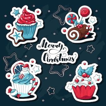 Insieme di vettore disegnato a mano di doodle di simpatici adesivi di natale con cupcakes e dolci ed elementi e scritte di natale