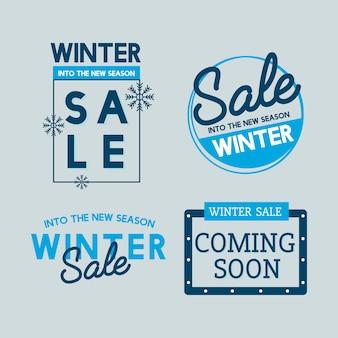 Insieme di vettori di distintivo di vendita invernale