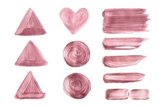 Insieme dipinto a mano della spazzola dell'oro di rosa isolato su fondo bianco