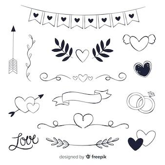 Insieme disegnato a mano dell'ornamento di nozze
