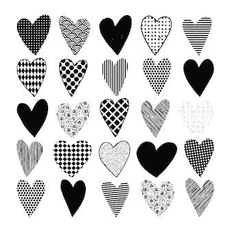 Insieme disegnato a mano di doodle cuori neri per san valentino