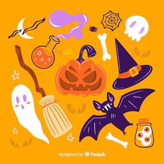 Insieme disegnato a mano di halloween degli elementi svegli su fondo arancio