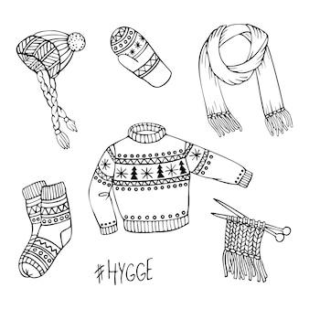 Insieme disegnato a mano di vettore di vestiti a maglia.