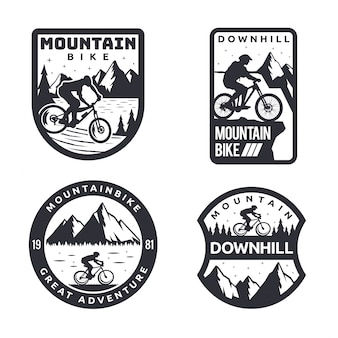 Insieme distintivo del distintivo di logo di mountain bike monotono d'annata