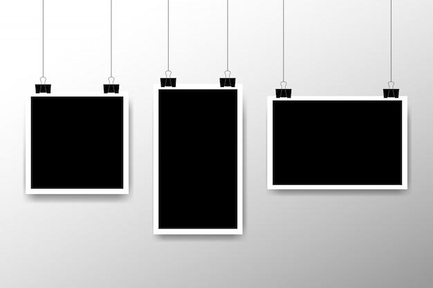 Insieme in bianco della struttura della foto che appende su una clip. stile vintage retrò. modello di disegno fotografico verticale e orizzontale. posto vuoto nero per il tuo testo o foto. modello di disegno realistico icona foto dettagliate.