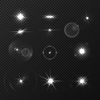 Insieme realistico dei chiarori bianchi neri dell'obiettivo isolato