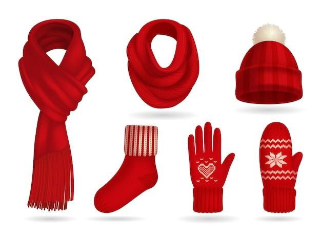 Insieme realistico dei vestiti tricottati rosso di inverno con i guanti e la sciarpa isolati