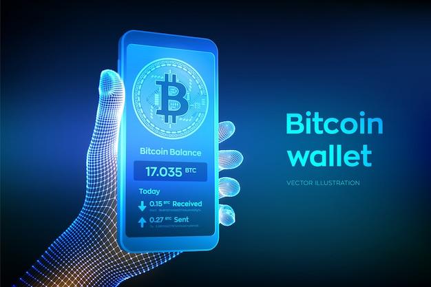 Interfaccia portafoglio bitcoin sullo schermo dello smartphone. telefono cellulare del primo piano in mano del wireframe.