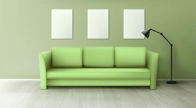 Interno con divano verde, lampada e poster bianchi vuoti