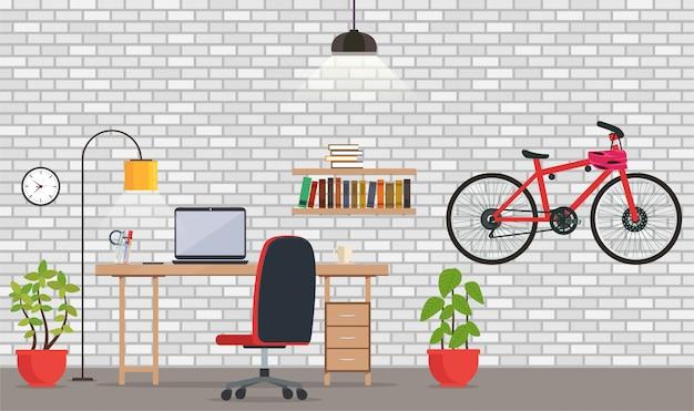 Interno dell'ufficio o della stanza con il muro di mattoni bianco.