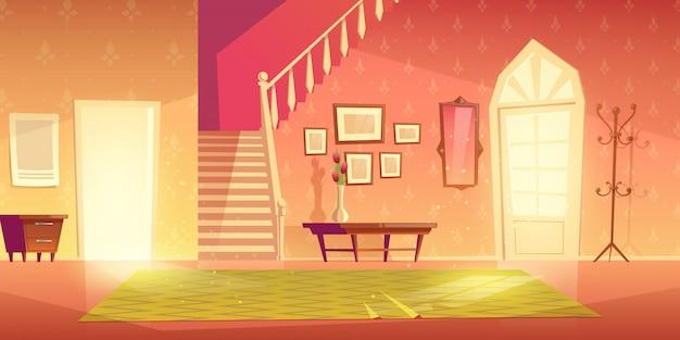 Interno di ingresso del corridoio di casa con mobili.